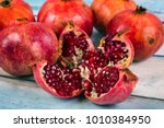 red juice pomegranate on blue... | Shutterstock . vector #1010384950