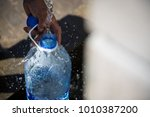 collecting natural spring water ... | Shutterstock . vector #1010387200