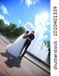 bride and groom hugging and... | Shutterstock . vector #1010401339