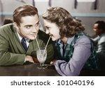 couple in a restaurant looking... | Shutterstock . vector #101040196