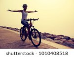 free woman cyclist riding bike... | Shutterstock . vector #1010408518