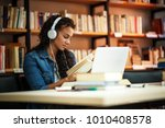 young female student study in... | Shutterstock . vector #1010408578