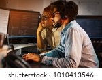 two programmers working on new... | Shutterstock . vector #1010413546