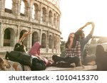 three young friends tourists... | Shutterstock . vector #1010415370