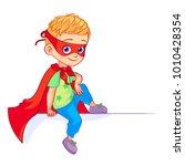 little cute super boy sitting...   Shutterstock .eps vector #1010428354
