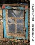 old window in abandoned rural... | Shutterstock . vector #1010432968