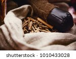 cinnamon sticks in a fabric bag ... | Shutterstock . vector #1010433028
