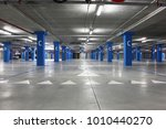 an empty big underground parking | Shutterstock . vector #1010440270