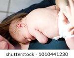mother holding her newborn baby ...   Shutterstock . vector #1010441230