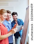 young start up team with tablet ... | Shutterstock . vector #1010446459