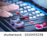 close up hands sound mixer... | Shutterstock . vector #1010455258