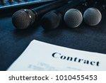 microphones  the contract... | Shutterstock . vector #1010455453