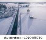 countryside on snowy winter day.... | Shutterstock . vector #1010455750