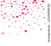 pink hearts confetti falling on ... | Shutterstock .eps vector #1010458510