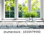 desk of free space with green... | Shutterstock . vector #1010479450