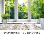 desk of free space with green... | Shutterstock . vector #1010479459