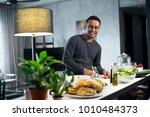 happy asian man preparing food... | Shutterstock . vector #1010484373