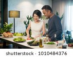happy asian couple preparing... | Shutterstock . vector #1010484376