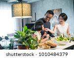 happy asian family preparing... | Shutterstock . vector #1010484379
