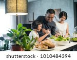 happy asian family preparing... | Shutterstock . vector #1010484394
