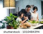 happy asian family preparing... | Shutterstock . vector #1010484394