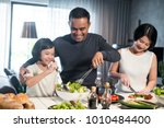 happy asian family preparing... | Shutterstock . vector #1010484400