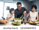 happy asian family preparing... | Shutterstock . vector #1010484403
