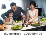 happy asian family preparing... | Shutterstock . vector #1010484406