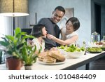happy asian family preparing... | Shutterstock . vector #1010484409