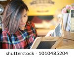 young women in coffee shop | Shutterstock . vector #1010485204