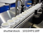 conveyor with products of... | Shutterstock . vector #1010491189