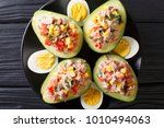 ripe avocado with a salad of... | Shutterstock . vector #1010494063