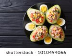 delicious snack of avocado... | Shutterstock . vector #1010494066
