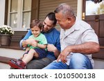 male multi generation family... | Shutterstock . vector #1010500138
