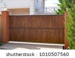 brown automatic wooden gates of ... | Shutterstock . vector #1010507560