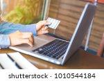 business woman hand holds a...   Shutterstock . vector #1010544184