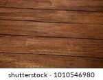 dark wooden texture. wood brown ... | Shutterstock . vector #1010546980