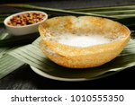 homemade appam served with... | Shutterstock . vector #1010555350