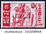 Small photo of ITALY - CIRCA 1935: A stamp printed in the Italy shows Man Holding Fasces, University Contest, circa 1935