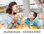mother and her son eating a...   Shutterstock . vector #1010612560