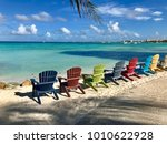 colorful wooden chairs on the...   Shutterstock . vector #1010622928