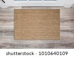 blank tan colored coir doormat... | Shutterstock . vector #1010640109