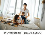 dad  mom and two year old... | Shutterstock . vector #1010651500
