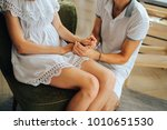 loving couple holds hands | Shutterstock . vector #1010651530