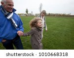 grandparents and granddaughter... | Shutterstock . vector #1010668318