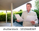 senior business man reads data   Shutterstock . vector #1010668369
