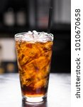 glass of soft drink with ice ... | Shutterstock . vector #1010670658