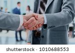 close up of businessmen shaking ... | Shutterstock . vector #1010688553