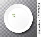 almost empty plain white plate... | Shutterstock .eps vector #1010700214