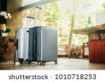 two gray large suitcases stand... | Shutterstock . vector #1010718253